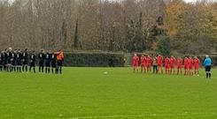 Players observing a minute's silence at the weekend