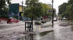 Vehicles drive on a flooded street in Sydney, New South Wales, Australia November 28, 2018 in this still image taken from a video obtained from social media. @DeeCee451/via REUTERS THIS IMAGE HAS BEEN SUPPLIED BY A THIRD PARTY. MANDATORY CREDIT. NO RESALES. NO ARCHIVES.
