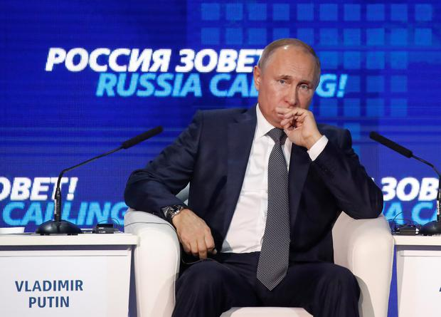 Russian President Vladimir Putin attends a session of the VTB Capital Investment Forum