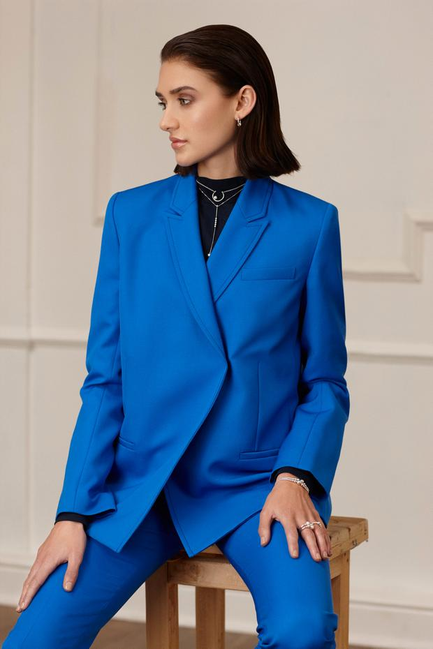 Blue jacket, €815, and trousers, €475, Victoria Beckham, Gallery 9, Naas. Navy poloneck, €110, Wonderound, Beautiful South. Pearl hoop earrings, €79; pearl necklace, €79; String of Beads necklace, €69, and matching bracelet, €59; pearl ring, €59; String of Beads ring, €45, all Pandora