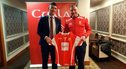 Willie Maher (left) with Cuala chairman, Barry O' Halloran.