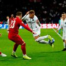 Neymar attempts to flick the ball over the head of Xherdan Shaqiri in Paris. Photo: Andrew Boyers/Action Images via Reuters