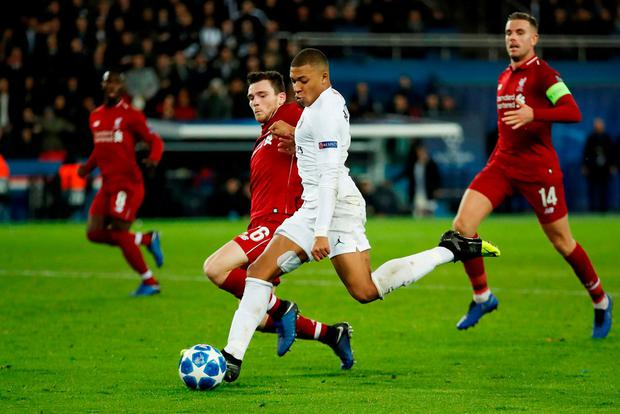 Paris St Germain's Kylian Mbappe shoots at goal as Liverpool's Andrew Robertson attempts to block. Photo: Andrew Boyers/Action Images via Reuters