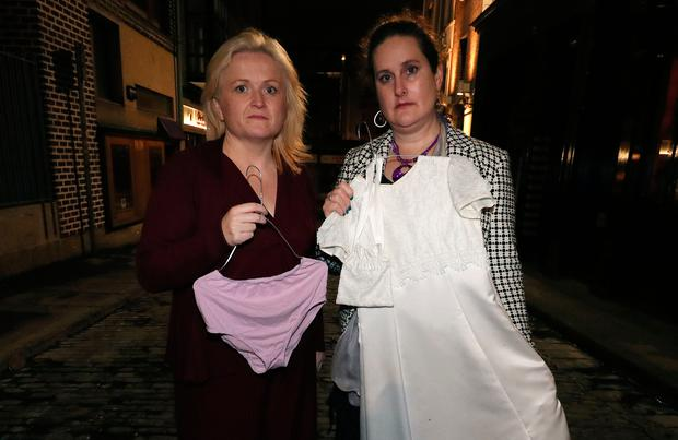 Leona O'Callaghan, (left) founder of Survivors Support Anonymous, and Hazel Larkin of Action Against Sexual Violence Ireland, hold items of clothing from the 'Not Consent' exhibition which takes place in 'Street 66' in Dublin's city centre. The exhibition features clothing worn by victims of abuse at the time they were assaulted. Photo: Brian Lawless/PA Wire