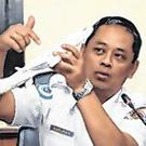 Investigation: Safety expert Nurcahyo Utomo with model plane. Photo: Darren Whiteside/Reuters