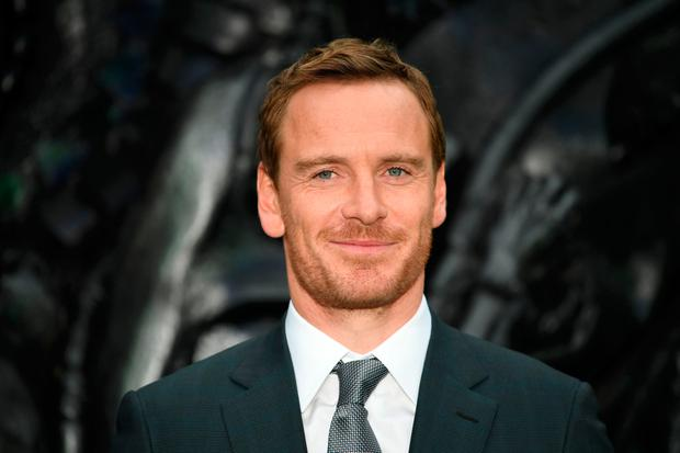 German-born Irish actor Michael Fassbender poses for a photograph upon arrival at the world premiere of