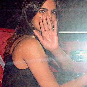 Indian Bollywood actress Priyanka Chopra departs following the conclusion of an event in Mumbai on November 27, 2018. (Photo by - / AFP)-/AFP/Getty Images