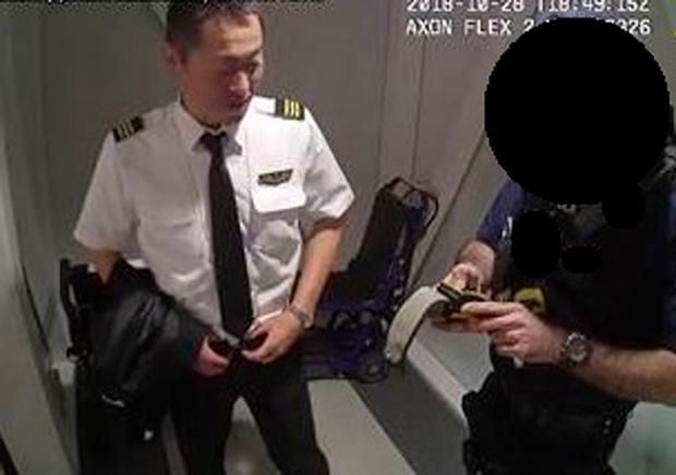 Undated handout CCTV image issued by Metropolitan Police of Japanese pilot Katsutoshi Jitsukawa being arrested after failing a breath test just 50 minutes before Japan Airlines (JAL) flight JL44 to Tokyo was due to take off with him in the cockpit as he has been jailed for 10 months at Isleworth Crown Court in London today. Photo: PA