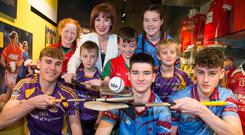 'Red-letter day': Culture Minister Josepha Madigan with young hurling and camogie players at Croke Park yesterday to celebrate the news. Photo: Colin O'Riordan