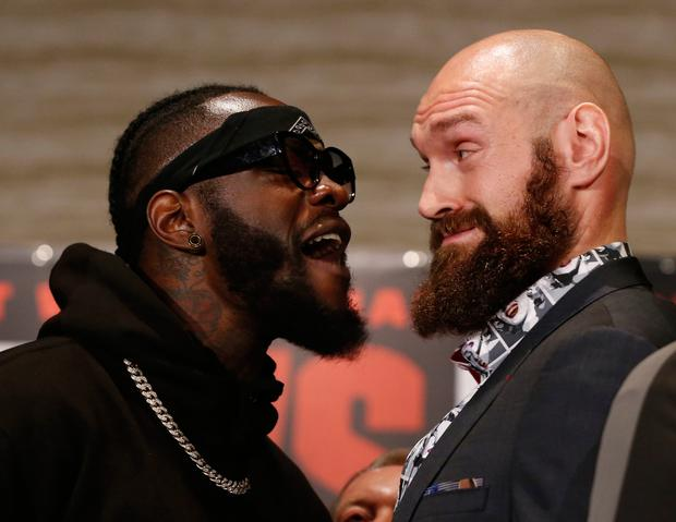 Deontay Wilder and Tyson Fury exchanged words when as they faced each other at a news conference in Los Angeles this week Pic: AP