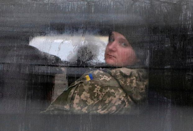 A detained Ukrainian serviceman and crew member of one of Ukrainian naval ships which were recently seized by Russia's FSB security service looks out of a minibus window outside a court building in Simferopol Crimea