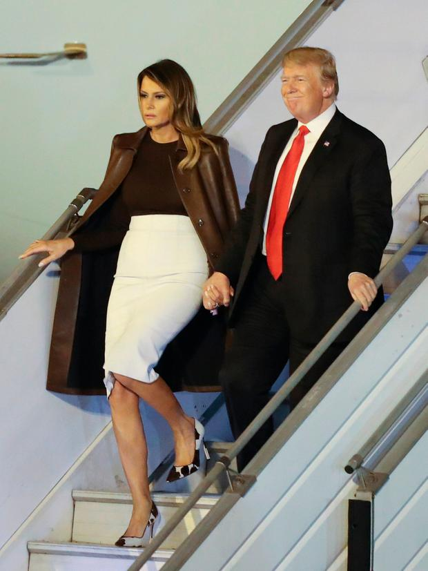 President Donald Trump and first lady Melania Trump walk from Air Force One, Thursday, Nov. 29, 2018, as they arrive at the Ministro Pistarini international airport in Buenos Aires, Argentina. Trump traveled to Argentina to attend the G20 summit. (AP Photo/Martin Mejia)