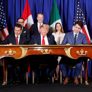 U.S. President Donald Trump, Canada's Prime Minister Justin Trudeau and Mexico's President Enrique Pena Nieto sign documents during the USMCA signing ceremony before the G20 leaders summit in Buenos Aires, Argentina November 30, 2018. REUTERS/Kevin Lamarque
