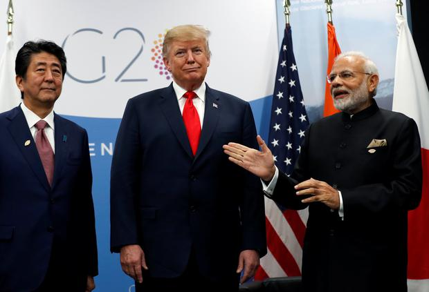 U.S. President Donald Trump meets Japanese Prime Minister Shinzo Abe and Indian Prime Minister Narendra Modi during the G20 leaders summit in Buenos Aires, Argentina November 30, 2018. REUTERS/Kevin Lamarque