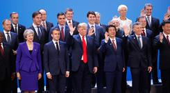 World leaders participate in a family photo at the G20 summit, Friday, Nov. 30, 2018 in Buenos Aires, Argentina. (AP Photo/Pablo Martinez Monsivais)