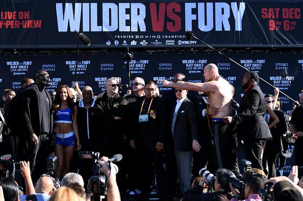 LOS ANGELES, CA - NOVEMBER 30: Tyson Fury taunts Deontay Wilder during the Deontay Wilder v Tyson Fury weigh-in at Los Angeles Convention Center on November 30, 2018 in Los Angeles, California. (Photo by Harry How/Getty Images)