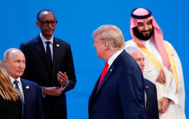 US President Donald Trump walks past Russia's President Vladimir Putin, Rwandan President and African Union chairperson Paul Kagame, Saudi Crown Prince Mohammed bin Salman and Brazil's President Michel Temer as he arrives for a 'family' photo during the G20 leaders summit in Buenos Aires, Argentina. Photo: Reuters