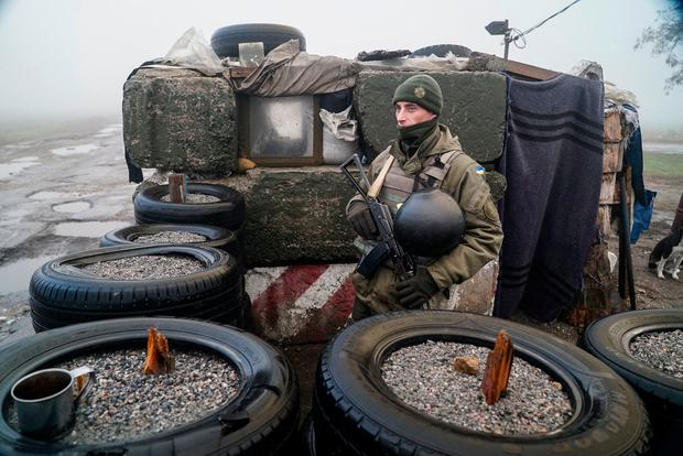 A Ukrainian national guard soldier stands at the checkpoint in Berdyansk, on the south coast of Azov sea, eastern Ukraine. Photo: AP