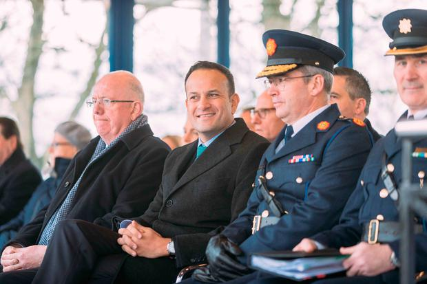 New recruits: Minister Charlie Flanagan, Taoiseach Leo Varadkar and Garda Commissioner Drew Harris at the passing out ceremony in Templemore yesterday. Photo: Eamon Ward