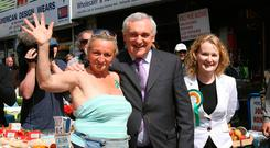 All smiles: Ex-Taoiseach Bertie Ahern meets stall owners on Dublin's Moore Street as he canvasses in 2007 for the general election. Photo: Niall Carson/PA Wire