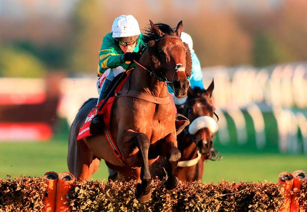 Unowhatimeanharry, ridden by Barry Geraghty, on the way to winning The Ladbrokes Long Distance Hurdle Race at Newbury yesterday. Photo: Simon Cooper/PA Wire