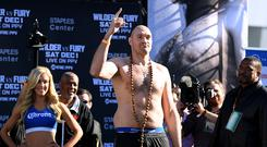 LOS ANGELES, CA - NOVEMBER 30: Tyson Fury plays to the crowd during the Deontay Wilder v Tyson Fury weigh-in at Los Angeles Convention Center on November 30, 2018 in Los Angeles, California. (Photo by Harry How/Getty Images)