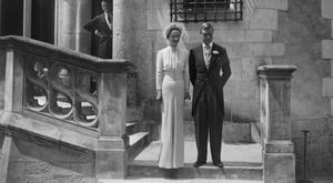 Edward, Duke of Windsor, and formerly Edward VIII of England, and his wife Wallis Simpson, are seen, 03 June 1937, during their wedding, at Chateau de Candé, Monts, France. Edward VIII of England, eldest son of George V and Mary of Teck, abdicated because of his love affair with American-born divorcee Wallis Simpson. After his abdication, he became Duke of Windsor and married Mrs. Simpson, who had changed her name by deed poll to Wallis Warfield, in a private ceremony on 3 June 1937. (Photo credit should read OFF/AFP/Getty Images)