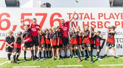 Brian O'Driscoll (left) and Bryan Habana (right) with kids at the HSBC Dubai Sevens.