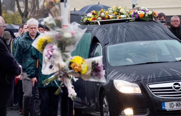 The funeral cortege of Stephen Marron passes the scene of the accident in Main Street Casleblaney. Photo: Tony Gavin 1/12/2018