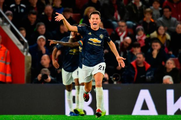 Manchester United's Spanish midfielder Ander Herrera celebrates scoring their second goal to equalise 2-2 during the English Premier League football match between Southampton and Manchester United at St Mary's Stadium in Southampton, southern England on December 1, 2018. (Photo by Glyn KIRK / AFP)