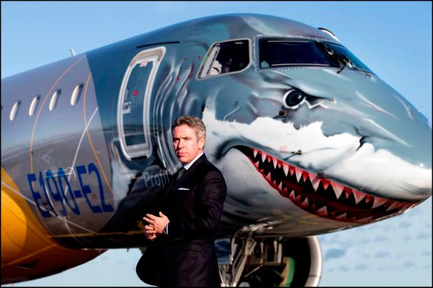 John Slattery, CEO of Embraer Commercial Aviation, with the new Embraer E190-E2 passenger jet. Picture by David Conachyleasing