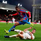 Burnley and Republic of Ireland defender Kevin Long tackles Crystal Palace's Wilfried Zaha during yesterday's Premier League match at Selhurst Park, which the home side won 2-0. Photo: Peter Cziborra/Action Images via Reuters