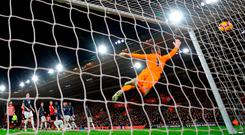 Manchester United's goalkeeper David De Gea can't reach the ball as Southampton's Cedric Soares finds the net from a free-kick for his side's second goal. Photo: Glyn KIRK / AFP