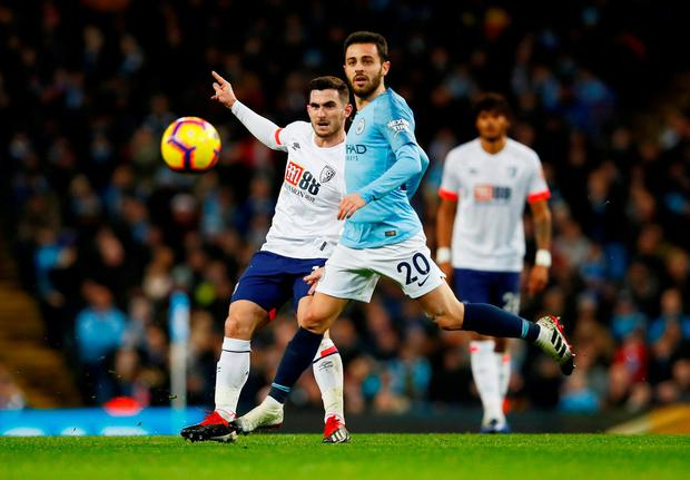 Bournemouth's Lewis Cook in action with Manchester City's Bernardo Silva. Photo: Jason Cairnduff/Action Images via Reuters