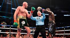 Deontay Wilder and Tyson Fury during the WBC Heavyweight Championship bout at the Staples Center in Los Angeles.: Lionel Hahn/PA Wire