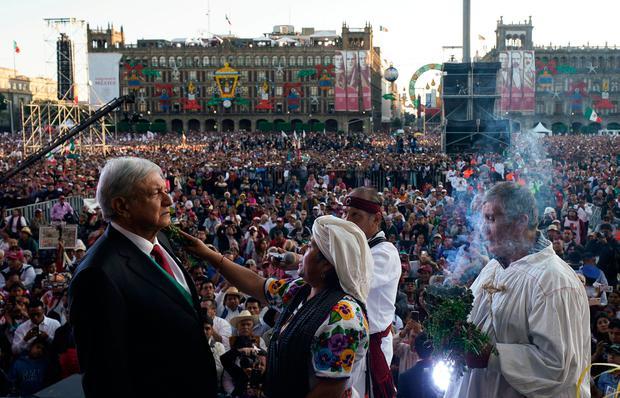 Mexico's President Andres Manuel Lopez Obrador takes part in an indigenous ceremony at the AMLO Fest at Zocalo square in Mexico City, Mexico December 1, 2018. Picture taken December 1, 2018. Press Office Andres Manuel Lopez Obrador/Daniel Aguilar/Handout via REUTERS