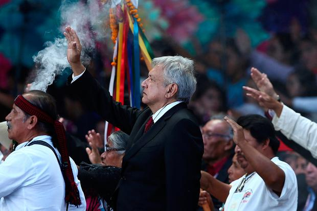 Mexico's President Andres Manuel Lopez Obrador takes part in an indigenous ceremony during the AMLO Fest at Zocalo square in Mexico City, Mexico December 1, 2018. Picture taken December 1, 2018. REUTERS/Edgard Garrido