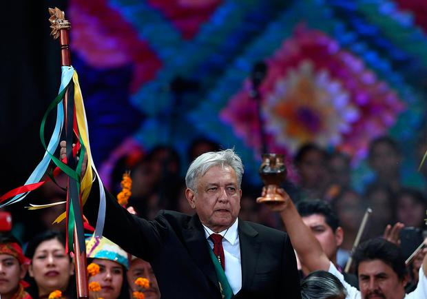 Mexico's President Andres Manuel Lopez Obrador holds up the staff of command received from indigenous people at the AMLO Fest at Zocalo square in Mexico City, Mexico December 1, 2018. Picture taken December 1, 2018. REUTERS/Edgard Garrido