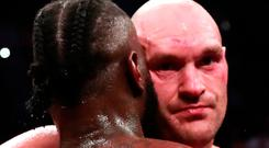 Deontay Wilder and Tyson Fury react after the fight in December. Action Images via Reuters/Andrew Couldridge
