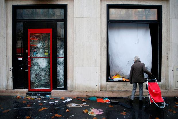 A vandalized bank front is seen the morning after clashes with protesters wearing yellow vests, a symbol of a French drivers' protest against higher diesel fuel taxes, in Paris, France, December 2, 2018. REUTERS/Stephane Mahe