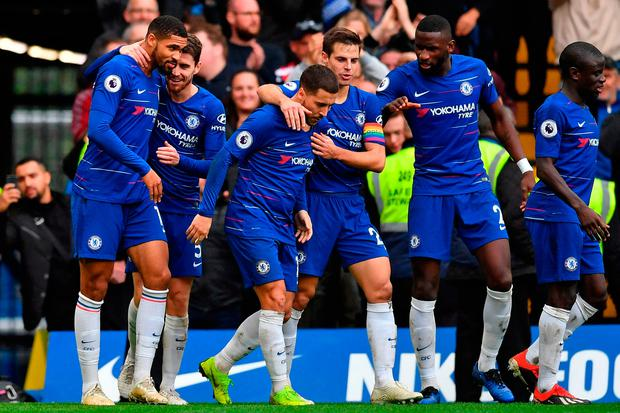 Chelsea's English midfielder Ruben Loftus-Cheek (L) celebrates with teammates after scoring their second goal during the English Premier League football match between Chelsea and Fulham at Stamford Bridge in London on December 2, 2018. (Photo by Ben STANSALL / AFP)