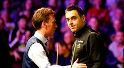 Ronnie O'Sullivan (right) after beating Ken Doherty, during day six of the Betway UK Championship at The York Barbican. PRESS ASSOCIATION Photo. Picture date: Sunday December 2, 2018. Photo credit should read: Martin Rickett/PA Wire