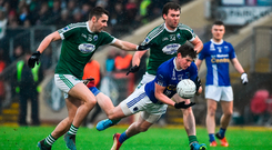 Scotstown's Darren Hughes has little room to manoeuvre as he is tackled by Michael Carroll (left) and Eamonn McGee of Gaoth Dobhair. Photo by Oliver McVeigh/Sportsfile