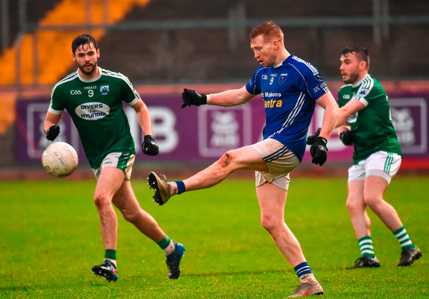 Kieran Hughes of Scotstown in action against Odhran MacNaillais of Gaoth Dobhair. Photo by Oliver McVeigh/Sportsfile