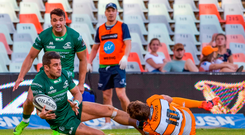 Tiernan O'Halloran of Connacht is tackled by Louis Fouche of Toyota Cheetahs in Bloemfontein. Photo by Frikkie Kapp/Sportsfile
