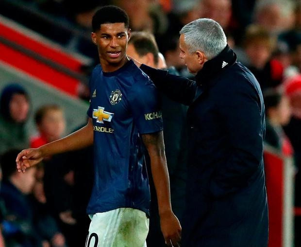 Jose Mourinho greets Marcus Rashford as the striker leaves the action after being substituted. Photo: Dan Istitene/Getty Images