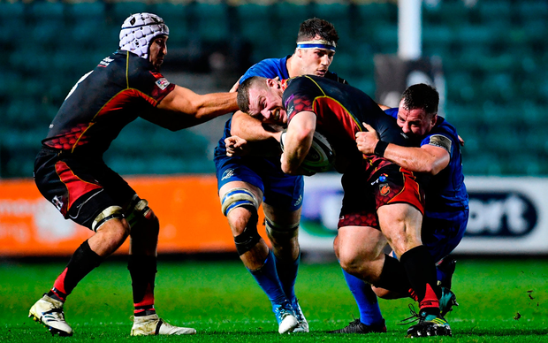 Lloyd Fairbrother of Dragons is tackled by Caelan Doris, left, and Bryan Byrne of Leinster. Photo by Ramsey Cardy/Sportsfile