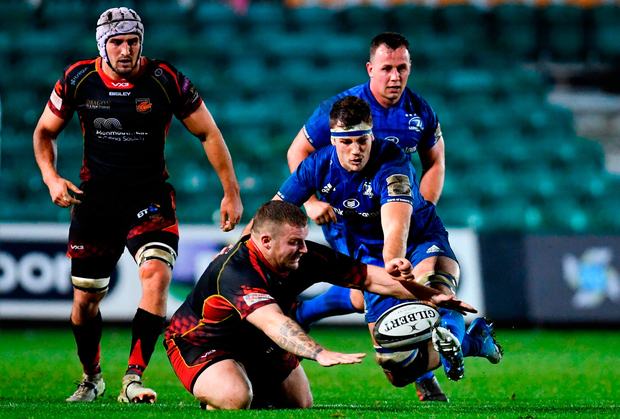 Caelan Doris of Leinster in action against Lloyd Fairbrother of Dragons. Photo by Ramsey Cardy/Sportsfile