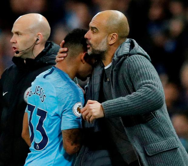 Gabriel Jesus is embraced by Pep Guardiola after being substituted against Bournemouth. Photo: Phil Noble/Reuters