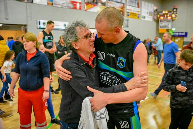 Star of the show: Billy Keane with Kieran Donaghy at the Cup victory of Tralee's Garvey's Warriors over UCC Demons yesterday.